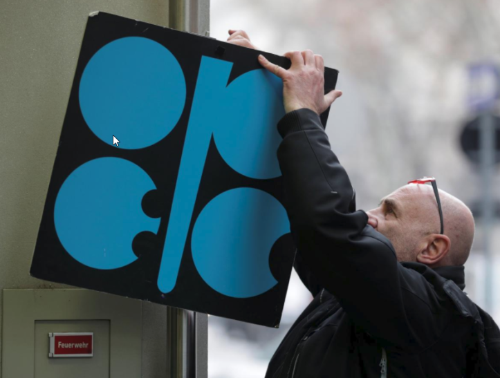 OPEC- A man fixes a sign with OPEC's logo next to its headquarter's entrance before a meeting of OPEC oil ministers in Vienna, Austria, November 29, 2017. REUTERS-Heinz-Peter Bader