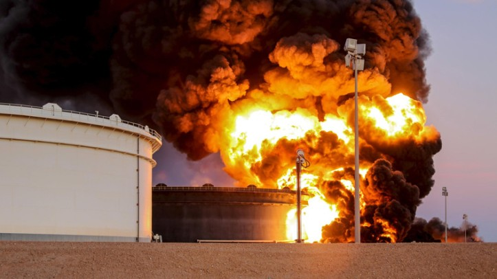 Fire rises from an oil tank in the port of Es Sider, in Ras Lanuf, Libya